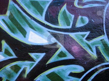 Graffiti on abandoned building stock photo, Green and black graffiti on an abandoned building by Annette Davis
