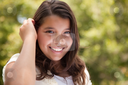 Cute Happy Girl in the Park stock photo, Cute Happy Hispanic Girl in the Park. by Andy Dean