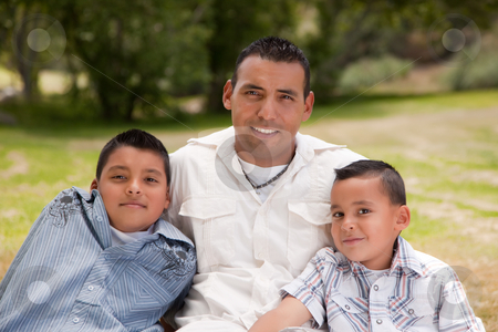 Father and Sons in the Park stock photo, Father and Sons Portrait in the Park. by Andy Dean