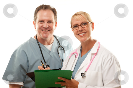 Male and Female Doctors Looking Over Files stock photo, Male and Female Doctors Looking Over Files Isolated on a White Background. by Andy Dean