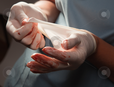 Abstract of Doctors Bloody Surgical Gloves stock photo, Abstract of Doctors Bloody Surgical Gloves and Scrubs. by Andy Dean