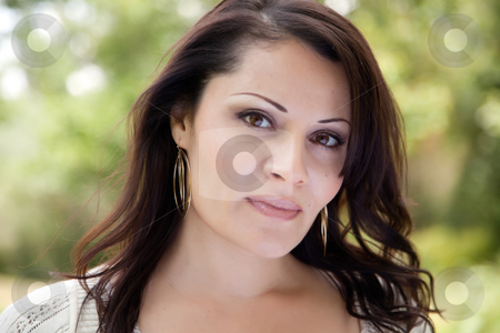 Attractive Woman in the Park stock photo, Attractive Hispanic Woman Portrait in the Park. by Andy Dean