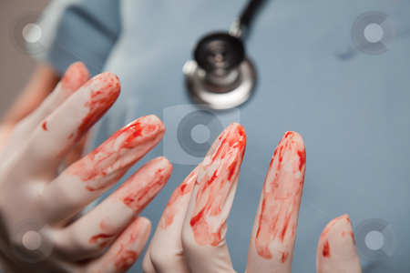 Abstract of Bloody Surgical Gloves stock photo, Abstract of Doctors Bloody Surgical Gloves, Scrubs and Stethoscope. by Andy Dean