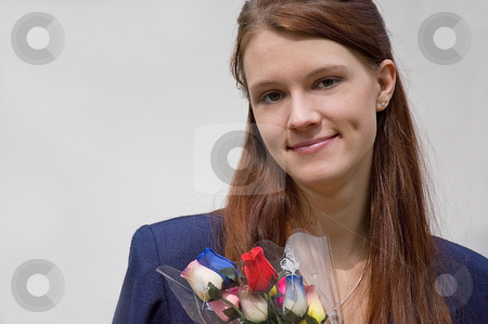 Career Woman With Flowers stock photo, This young pretty Caucasian career woman in navy blazer is holding a bouquet of rose buds. by Valerie Garner