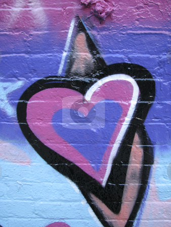 Heart painted on a brick wall stock photo, Graffiti purple and pink painted heart on brick wall by Annette Davis