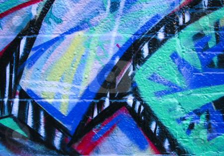 Multi color abstract brick background stock photo, Multi color graffiti background on brick by Annette Davis