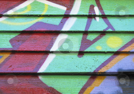 Red & green design painted on wood wall stock photo, Red and green graffiti on wood slatted wall by Annette Davis