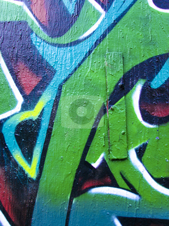 Brightly painted abstract concrete wall stock photo, Graffiti style painted concrete wall background by Annette Davis