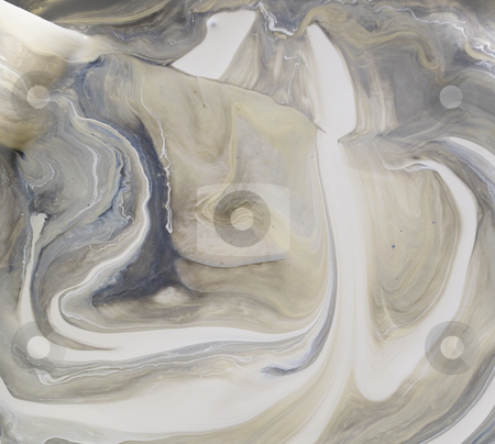Gray swirls of paint stock photo, Can of cream paint that has separated and looks like swirls of brown by Annette Davis