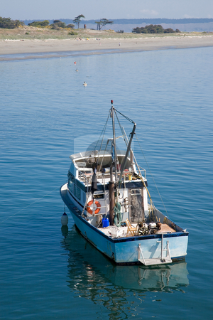 Small Fishing Boat stock photo, A close up on a small fishing boat in the bay. by Travis Manley