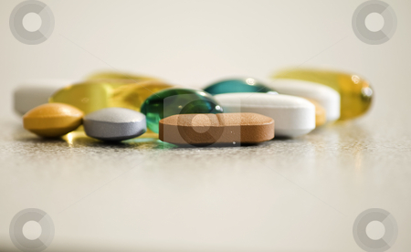 Drugs and vitamines stock photo, Some colourfull medication and vitamine pills by Arek Rainczuk