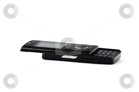 Black mobile phone stock photo, Black, slide-open mobile phone, isolated oven white by Arek Rainczuk