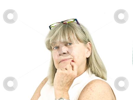 Portrait of thinking Senior Woman stock photo, Portrait of thinking senior woman on white background by John Teeter