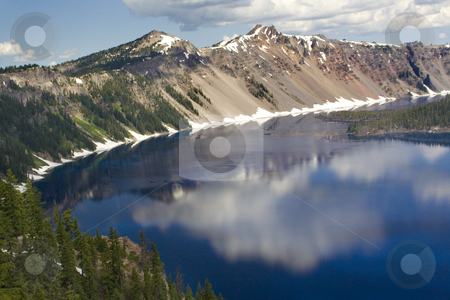 Crater Lake Reflections stock photo, Clouds Snow Mountains Reflections Crater Lake, National Park, Oregon by William Perry