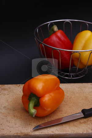 Chopping peppers stock photo, Bell pepper on chopping board by Torsten Lorenz