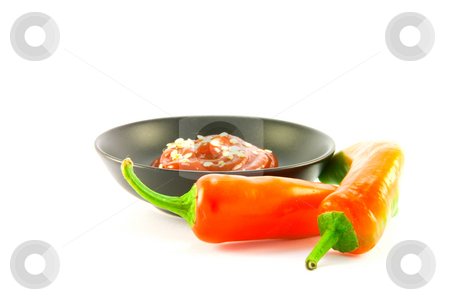 Chillis with Bowl of Chili Sauce stock photo, Two red chillis with small black bowl of chili dipping sauce with clipping path on a white background by Keith Wilson