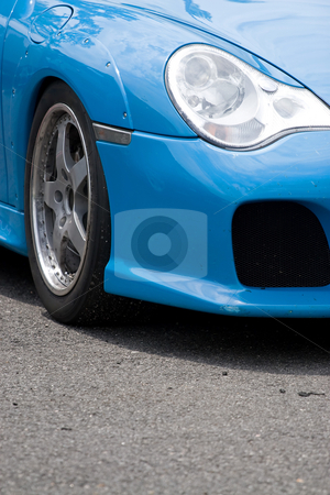 Sports Car Fender stock photo, A closeup of the custom rims and widebody kit on a modern sports car with plenty of copyspace. by Todd Arena