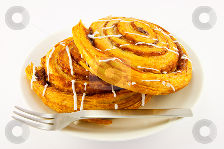 Two Cinnamon Buns and Fork stock photo, Two cinnamon buns and fork with clipping path on a white background by Keith Wilson
