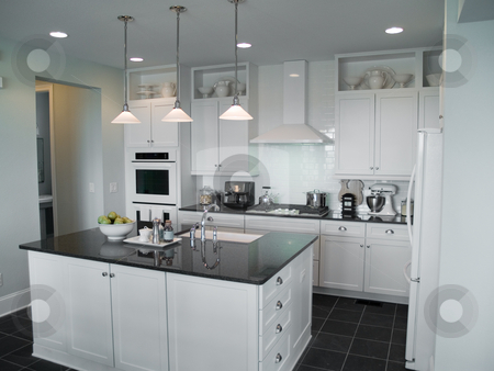 Interior Design stock photo, Beautiful modern kitchen with center island by Cora Reed