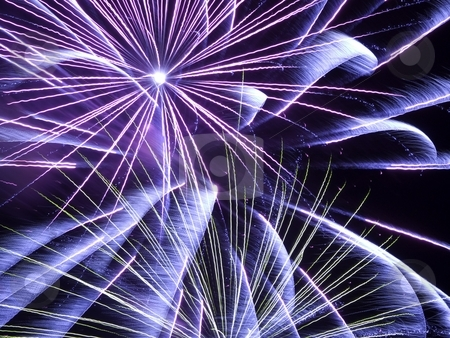 Fire works stock photo, Blue and purple fireworks in a dark sky by Cora Reed