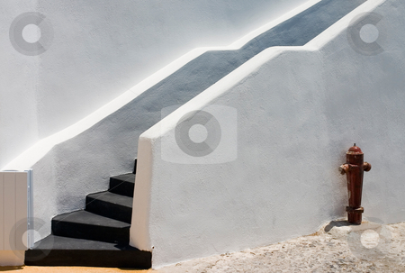 White wall with fire hydrant stock photo, Black stairs on white wall with fire hydrant by Wiktor Bubniak