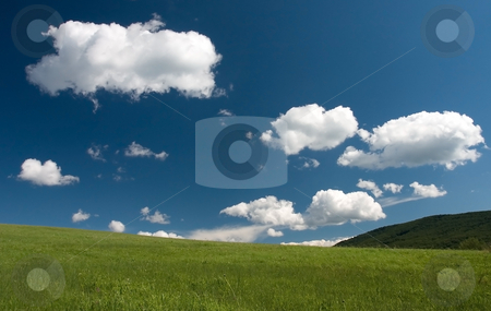 Green grass blue sky and white clouds stock photo, Beautiful european summer landscape with white clouds by Wiktor Bubniak