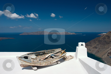 Old rowing boat on the roof stock photo, Old damaged  rowing boat placed on house roof by Wiktor Bubniak