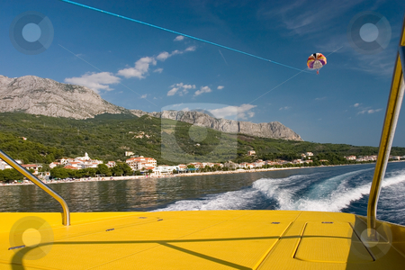 Parasailing in Croatia stock photo, Parasailing in Croatia. View from the boat by Wiktor Bubniak