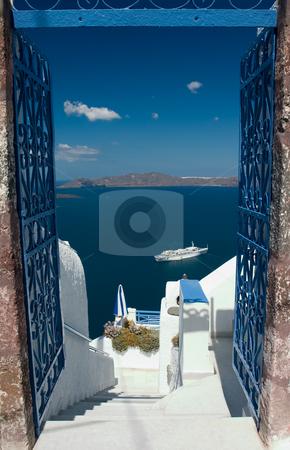 Welcome in Santorini stock photo, Open gates invites you to explore Santorini island by Wiktor Bubniak