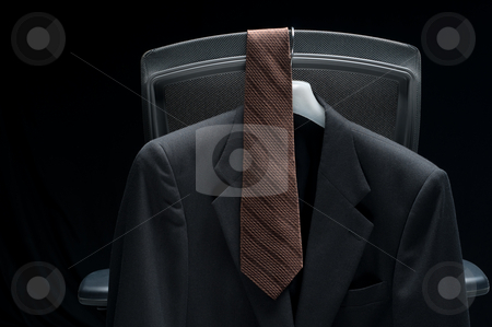 Business jacket and tie hanging on a chair stock photo, Business jacket and tie hanging on a chair by Vince Clements