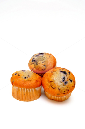 Blueberry Muffins stock photo, Three berry muffins on a light colored background by Lynn Bendickson