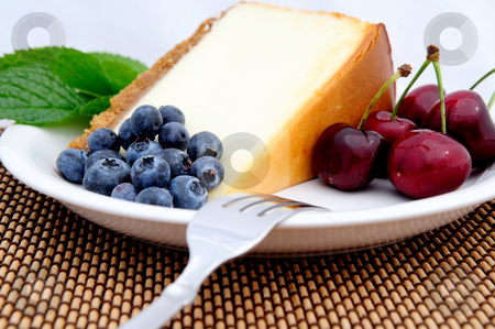 Cheese Cake, Cherries And Blueberries  stock photo, Seasonal fruit with a slice of plain cheese cake with a mint leaf garnish served on a white saucer. Blueberries and Bing cherries by Lynn Bendickson