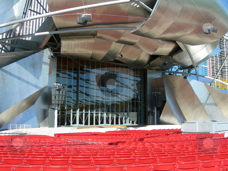 Chicago Theater stage stock photo, Chicago Millennium Park Theater stage structure with red seats in the foreground by Daniela Mangiuca
