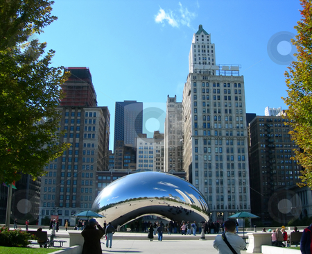 Chicago landmark and famous sculpture stock photo, Reflection of Chicago Skyline in the Millennium Park, famous Kapoor elliptical sculpture inspired by liquid mercury by Daniela Mangiuca