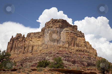 San Rafael Swell stock photo, Reed rouck formations  in Southern Utah with puffy clouds by Mark Smith