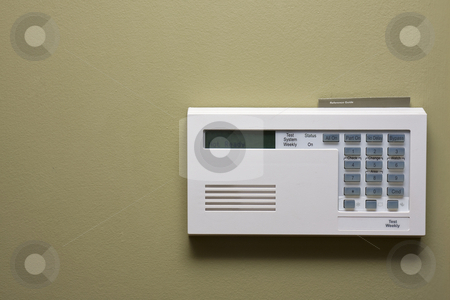 Home security control panel stock photo, Home security control panel on green wall by Chris Roselli
