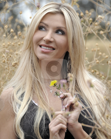 Woman in Field stock photo, A beautiful woman in a field by Timothy OLeary