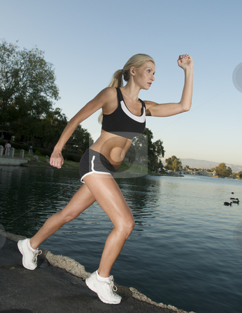 Woman Running stock photo, Woman runs to bephysically fit by Timothy OLeary