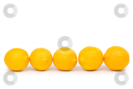 Golden lemon in a row stock photo, Isolated golden lemon in a row by Lawren