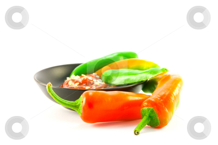 Chillis and Dipping Sauce in a Bowl stock photo, Whole chillis in a black bowl with red chilli dipping sauce and two red chillis outside the bowl with clipping path on a white background by Keith Wilson