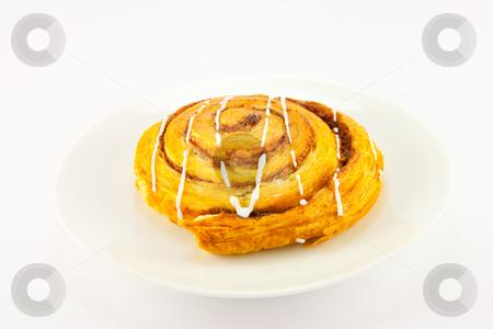Cinnamon Bun stock photo, Single cinnamon bun with clipping path on a white background by Keith Wilson