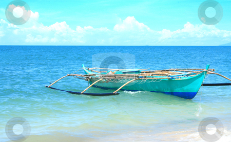 Boat stock photo, A boat floating on a tropical beach by Claro Alindogan
