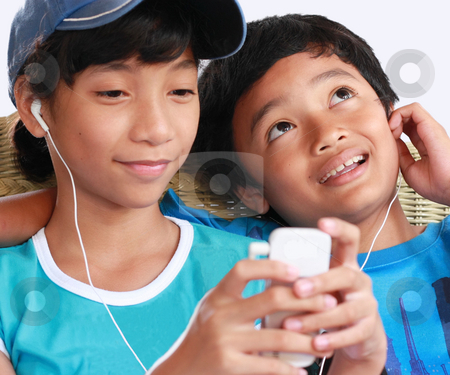 Music gadget stock photo, 2 kids music sharing by Claro Alindogan
