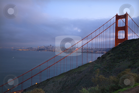 Headlands Golden Gate Bridge Evening with Lights of San Francisc stock photo, Golden Gate Bridge Headlands Evening with Lights of San Francisco California in background by William Perry