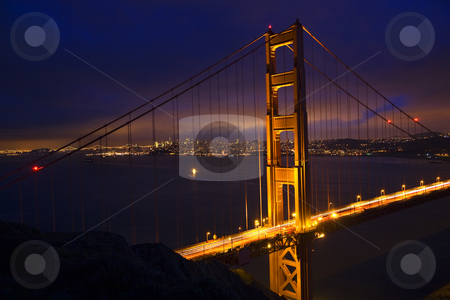 Golden Gate Bridge Night With Lights of San Francisco California stock photo, Golden Gate Bridge Night with Lights of San Francisco California in background by William Perry