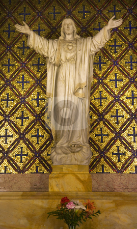 Jesus Statue Flowers Mission Dolores San Francisco California stock photo, Jesus Statue Flowers Mission Dolores Saint Francis De Assis Ornate Carving San Francisco California by William Perry