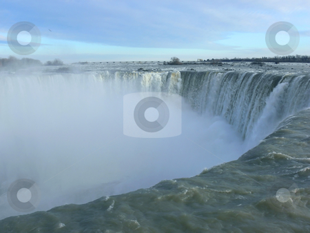 Niagara Falls. stock photo, The horseshoe falls in niagara falls Canada on a winter day with mist coming up, a close-up. by Horst Petzold