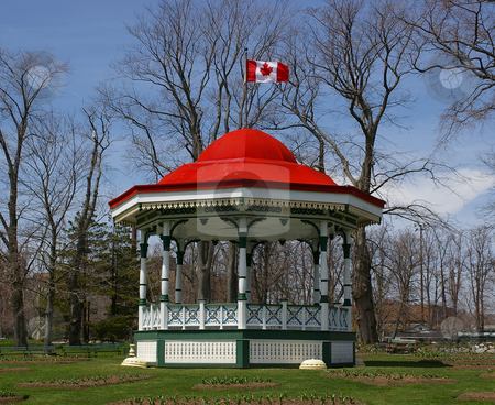 Bandstand stock photo, A historic bandstand with the flag flying high. by Tom Weatherhead