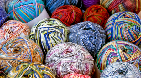 Rows of Multi Colored Yarn stock photo, This shot shows rows of many skeins of varied colored yarn. by Valerie Garner