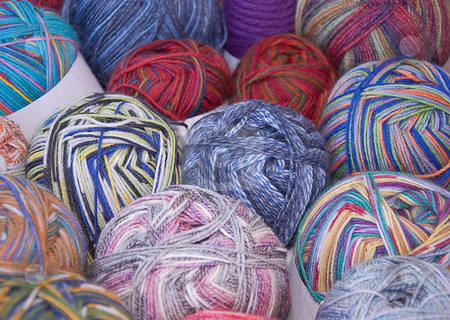 Rows of Varied Color Yarn stock photo, This photo features rows of varied color yarn, both bright and pastel. by Valerie Garner